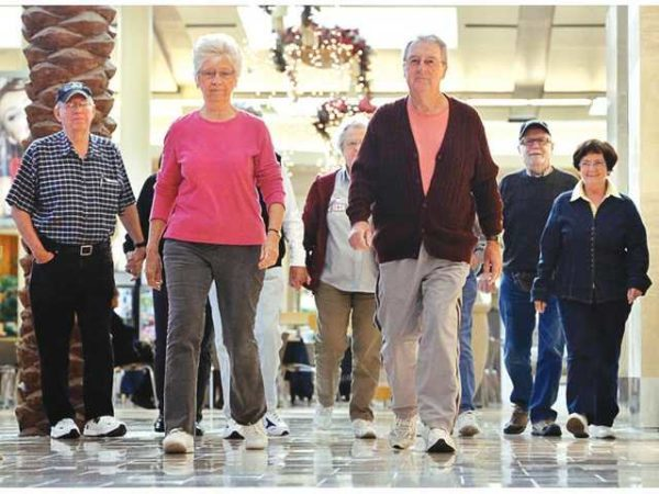 group of seniors walking in a mall