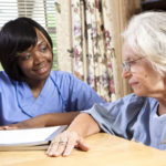 CNA working with older adult