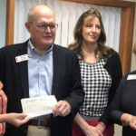 FUMS presenting grant check