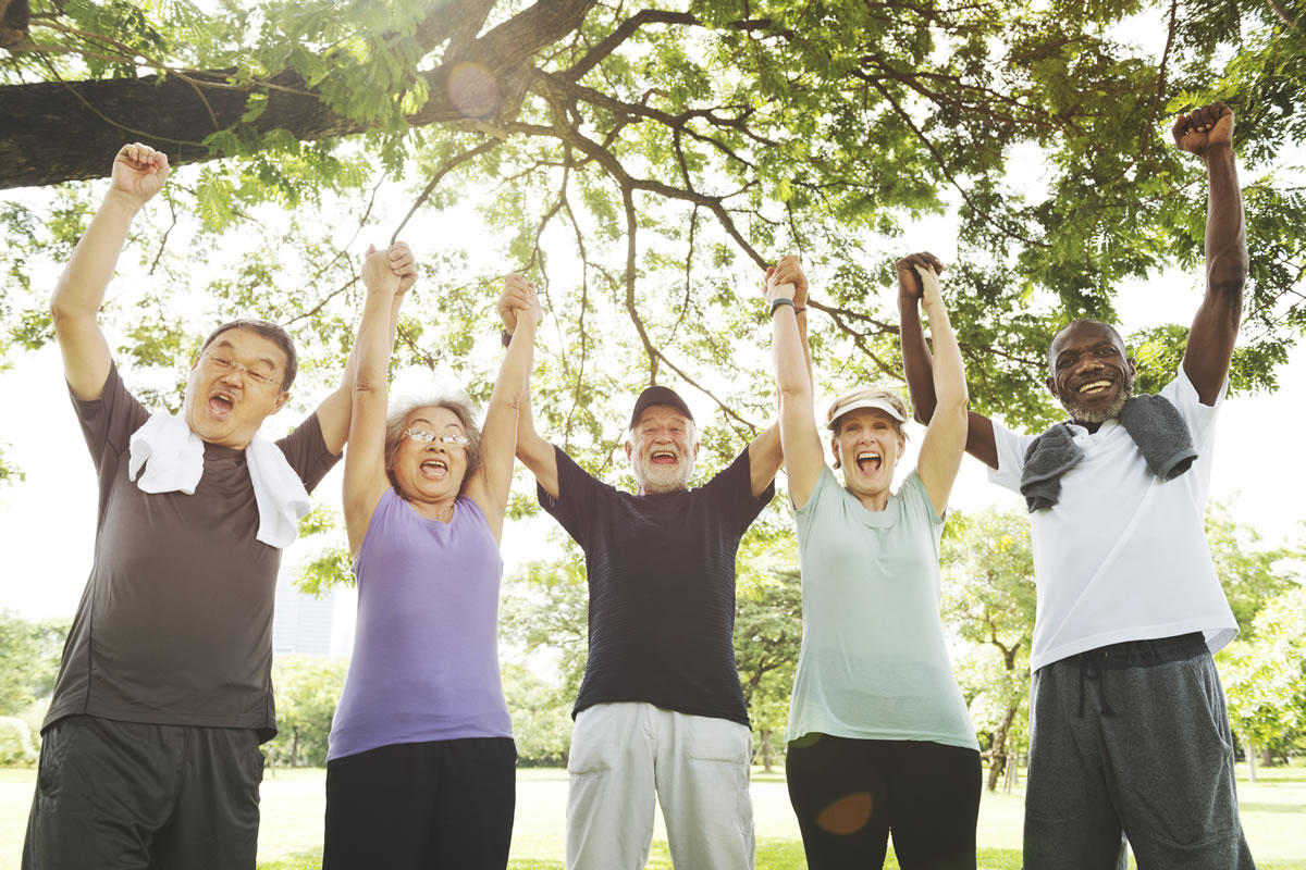 Group of adults outdoors. Learn to manage your diabetes.