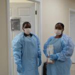 CNA, Caregiver Training students practice isolation techniques.