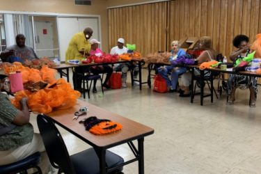 Group making fall wreaths