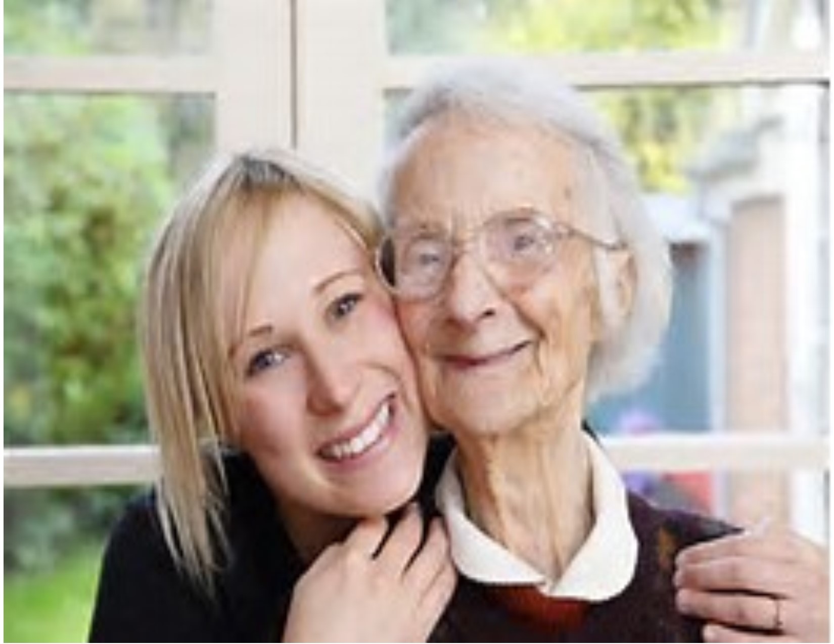 Young caregiver with elder woman