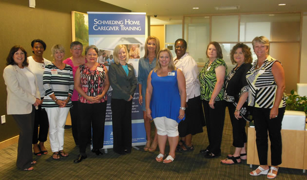 Schmieding staff poses with REST trainers at the UAMS Donald W. Reynolds Institute on Aging in LR